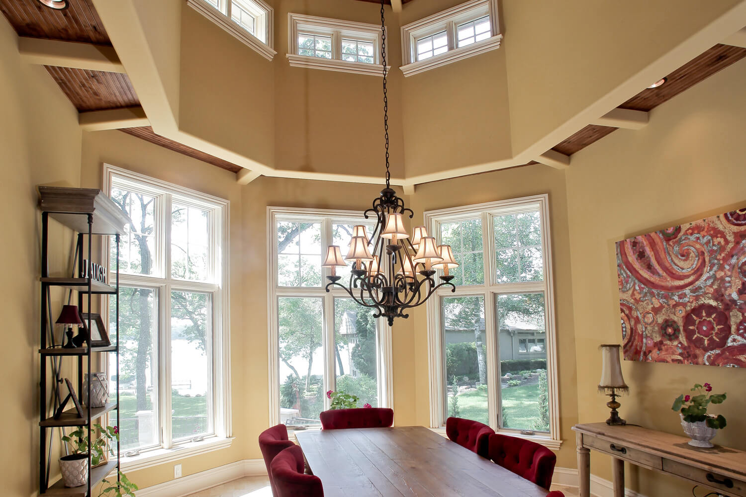 Two Story Dining Room With Wood T G Ceiling Drywall Beams And Stone Floor Windows Gothic Between Gl Grilles Showcasing Beautiful Views Of Beaver